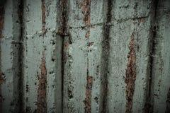 Alte Wandplanken knackten durch einen rustikalen Hintergrund Stockfotos