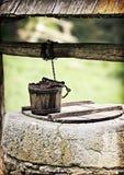 Alte Wasservertiefung Stockfotografie