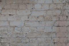 Alte weiße und graue Backsteinmauer Stockfotografie