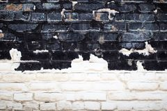 Alte weiße und schwarze Backsteinmauerbeschaffenheit für Hintergrund Stockbilder