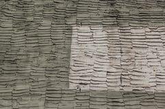 Alte Zementwand mit Muster der Kelle unterzeichnet stockfotografie