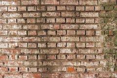 Alte zerschlagene Backsteinmauer Stockfoto