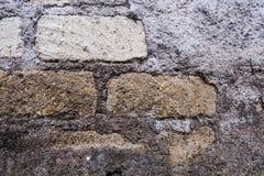 Alte Ziegelstein- und Betonmauerbeschaffenheit Lizenzfreies Stockbild