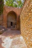 Alte Ziegelsteindurchgangtür im berühmten La Alcazaba in Malag Lizenzfreie Stockfotos