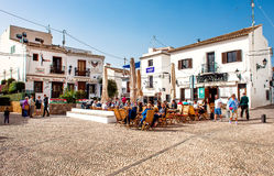 Altea town. Altea, Spain- February 22, 2016: Tourists sitting in a sidewalk cafe on a main square of Altea town. Altea is a most beautiful place in the Costa Stock Images