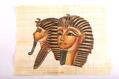 Alter ägyptischer König Tut Mask auf Papyrus lizenzfreies stockbild