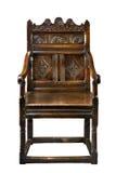 Alter antiker Eichenverkleidungsstuhl mit dem Schnitzen lokalisiert auf Weiß Stockfotografie
