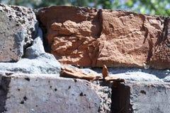 Alter Backsteinmauerbeschaffenheits-Nahaufnahmehintergrund stockfoto
