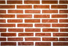 Alter Backsteinmauerhintergrund in der roten Farbe Stockbilder