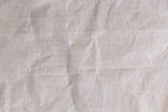 Alter Beschaffenheitshintergrund des braunen Papiers mit Falten Lizenzfreies Stockbild