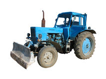 Alter blauer vintaje Traktor getrennt über Weiß Lizenzfreie Stockfotos