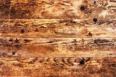 Alter brauner hölzerner Hintergrund und nichts anderes. Stockbilder