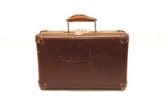 Alter brauner Koffer auf einem weißen Hintergrund Stockfoto