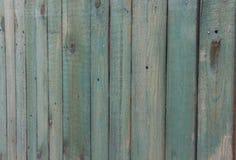 Alter Bretterzaun mit schäbiger blauer Farbe Hintergrund für Text, Karten und Künste lizenzfreie stockfotos