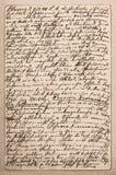Alter Buchstabe mit handgeschriebenem italienischem Text Stockfotografie