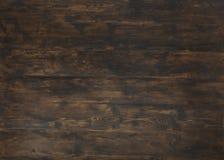 Alter dunkler strukturierter hölzerner Hintergrund, braunes Holz befleckte Art lizenzfreie stockfotografie