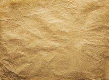 Alter geknitterter Papierhintergrund, Brown-Papier-Falten-Beschaffenheit lizenzfreies stockbild