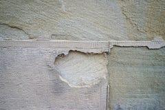 Alter geschädigter Steinwandhintergrund Stockfoto