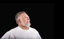 Alter Gesicht verziehendes Mann Stockbild