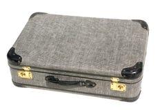 Alter grauer Koffer auf weißem Hintergrund Stockfotos