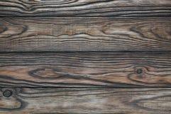 Alter hölzerner brauner Hintergrund von vier Brettern Stockfoto