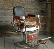 Alter Herrenfriseur-Stuhl. Stockbilder