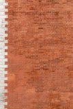 Alter Hintergrund des roten Backsteins Stockfotos