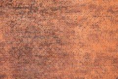 Alter kleinräumiger Hintergrund der Wand des roten Backsteins Stockfotos