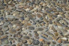 Alter Kopfstein auf der italienischen Straße Lizenzfreies Stockbild
