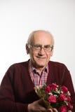 Alter Mann mit Blumen stockbilder