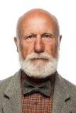 Alter Mann mit einem großen Bart und einem Lächeln Stockfotografie