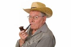 Alter Mann mit Hut und Rohr Lizenzfreie Stockbilder