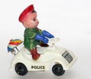 Alter merkwürdiger Polizeiwagen mit lustigem Treiber Stockbild