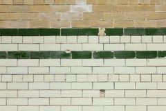 Alter mit Ziegeln gedeckter Backsteinmauer-Hintergrund Lizenzfreies Stockfoto