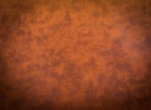 Alter orange lederner Hintergrund Stockfotos