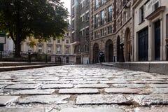 Alter Pflasterstein auf dem historischen Quadrat Lizenzfreies Stockbild