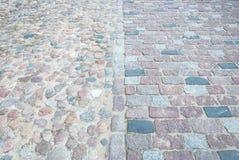 Alter quadratischer Steinboden als Beschaffenheit Lizenzfreies Stockfoto