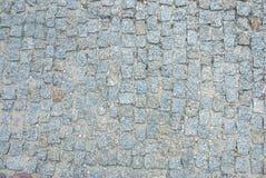 Alter quadratischer Steinboden als Beschaffenheit Stockbilder