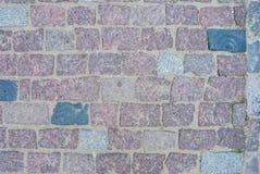 Alter quadratischer Steinboden als Beschaffenheit Stockfotos