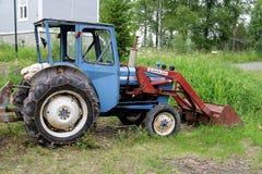 Alter rostiger Traktor Stockbilder