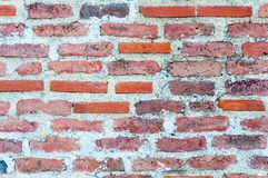 Alter roter Backsteinmauerbeschaffenheitshintergrund Lizenzfreies Stockfoto