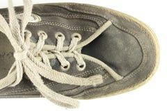 Alter schmutziger getragener Schuh Lizenzfreies Stockbild