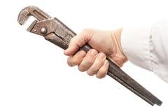 Alter Schraubenschlüssel in der männlichen Hand lokalisiert auf Weiß Lizenzfreies Stockbild