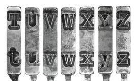 Alter Schreibmaschine Typebar beschriftet T bis Z lokalisiert auf Weiß Stockfotos