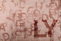 Alter Segeltuchhintergrund mit Buchstaben und Zahlen Lizenzfreies Stockbild