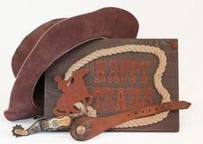 Alter Sporn mit westlichem Hut u. glückliche Spuren kennzeichnen Stockfotografie