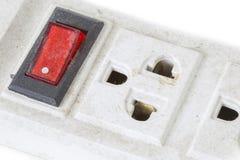 Alter Stecker und roter Schalter auf dem weißen Hintergrund lokalisiert Lizenzfreie Stockbilder