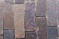 Alter Stein gepflasterte Straßennahaufnahme Lizenzfreie Stockfotos