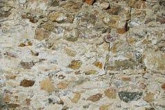Alter Steinwandhintergrund mit Zement Stockbild