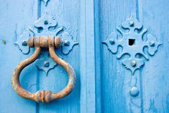 Alter Tür-Knopf Stockfoto